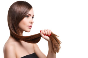 women holding long hair