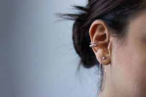 an ear with two piercings