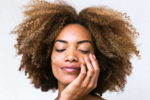 women with hand on her face and smooth skin