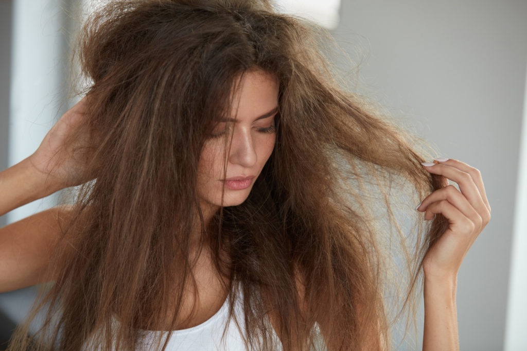 Woman With Holding Long Damaged Dry Hair. Hair Damage, Haircare.