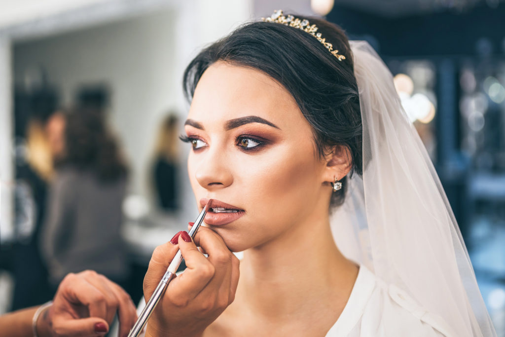 Pretty bride on makeup before weddiing